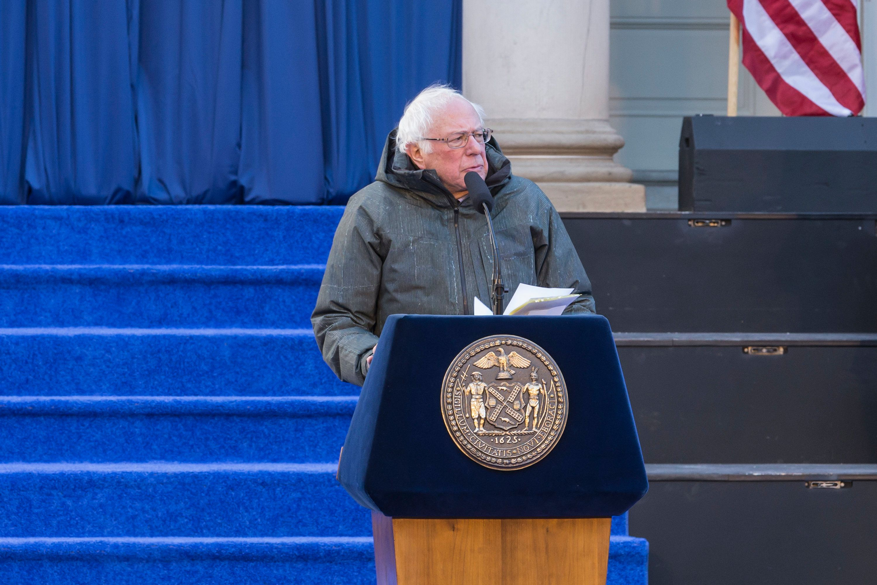 CITY HALL, NEW YORK, UNITED STATES - 2018/01/01: US Senator Bernie Sanders speaks during mayor, comptroller, public advocate inauguration for 2nd term in frigid weather in front of City Hall. (Photo by Lev Radin/Pacific Press/LightRocket via Getty Images)