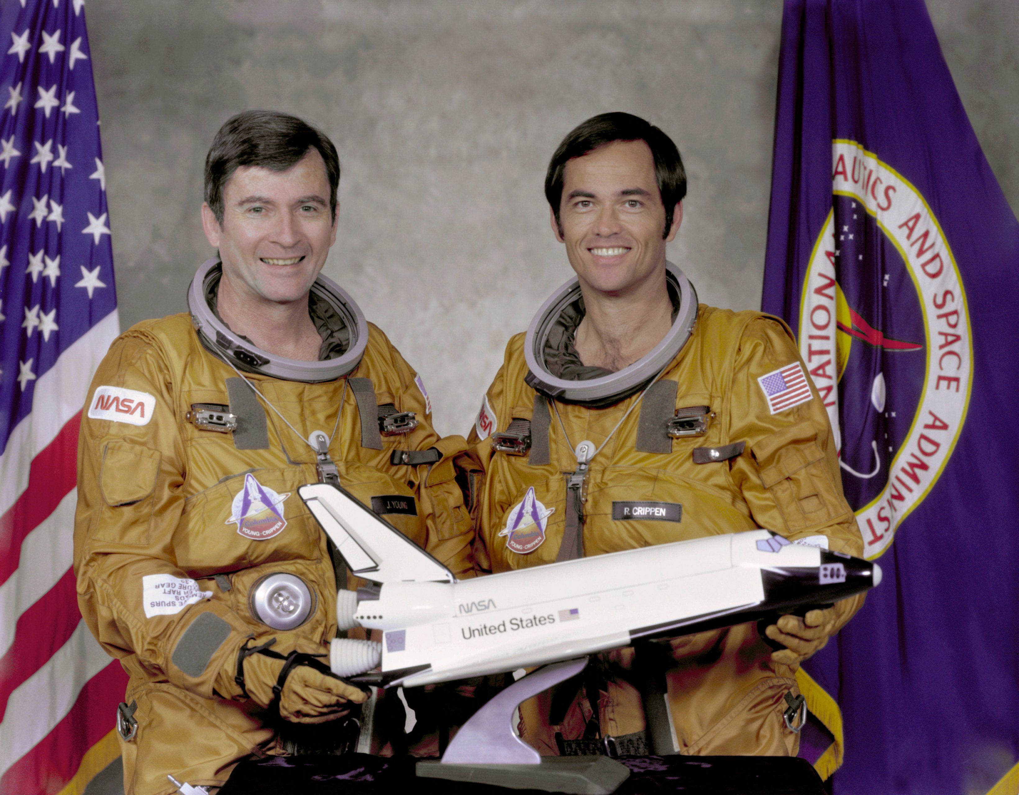STS-1 crew members Commander John Young (L) and Pilot Robert Crippen pose with a model of the Space Shuttle Columbia at Johnson Space Center in Houston May, 7, 1979. Young and Crippen flew the first orbital mission of NASA's space shuttle program aboard the Columbia.  REUTERS/NASA/Handout  (UNITED STATES - Tags: SCI TECH) FOR EDITORIAL USE ONLY. NOT FOR SALE FOR MARKETING OR ADVERTISING CAMPAIGNS. THIS IMAGE HAS BEEN SUPPLIED BY A THIRD PARTY. IT IS DISTRIBUTED, EXACTLY AS RECEIVED BY REUTERS, AS A SERVICE TO CLIENTS
