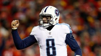 KANSAS CITY, MO - JANUARY 06:  Quarterback Marcus Mariota #8 of the Tennessee Titans celebrates a touchdown as the the Titans defeat the Kansas City Chiefs 22-21 to win the AFC Wild Card playoff game at Arrowhead Stadium on January 6, 2018 in Kansas City, Missouri.  (Photo by Jamie Squire/Getty Images)