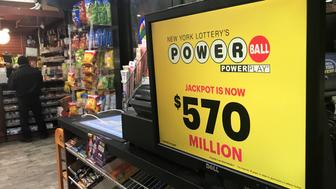 A Powerball sign is pictured in a store in New York City, New York, U.S., January 5, 2018. REUTERS/Carlo Allegri