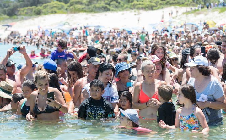Crowds cool off in water at Yarra Bay in Sydney, Australia, on Sunday amid a heat wave.