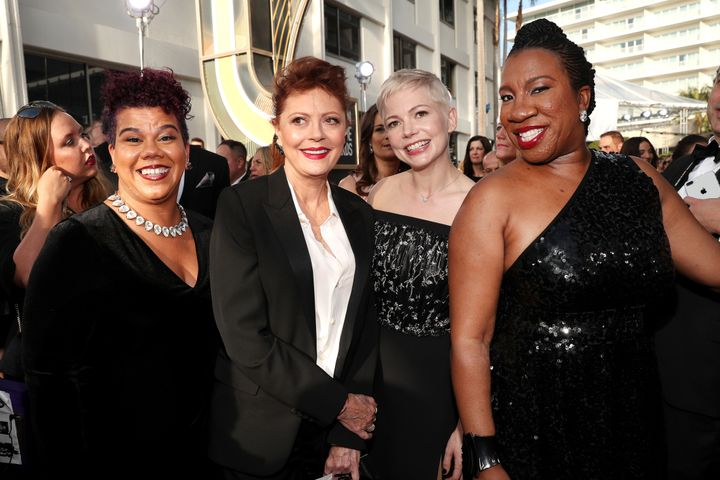 Actress Susan Sarandon brought activist Rosa Clemente as her guest on the red carpet. On the right, actress Michelle Williams