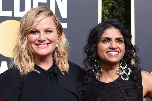 Amy Poehler and activist Saru Jayaraman at the Golden Globes Jan.