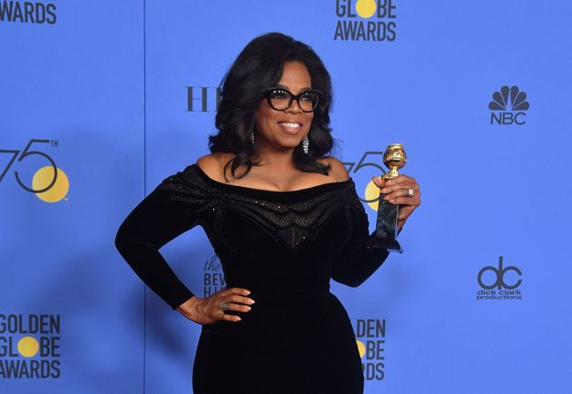 Oprah posing backstage with her