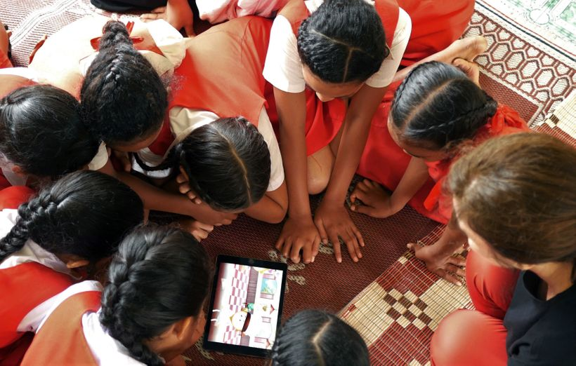 Students in Tonga engaging with an educational game together with producers from Millipede, an Australian innovation company