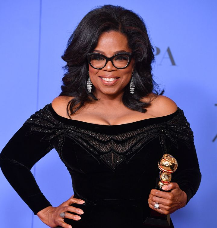Oprah Winfrey poses with the Cecil B. DeMille Award at the 75th Annual Golden Globe Awards on Sunday.