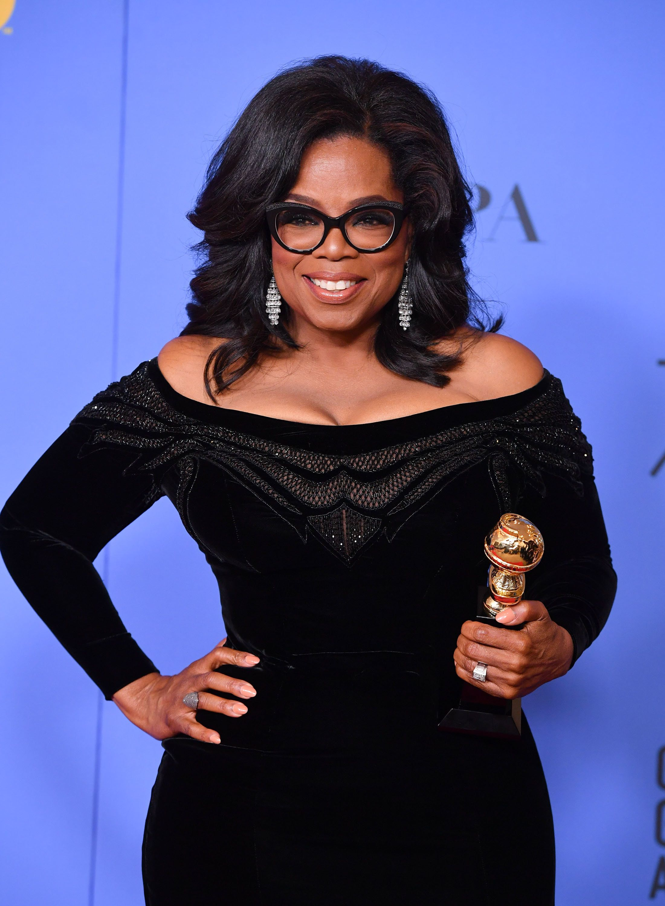 BEVERLY HILLS, CA - JANUARY 07:  Oprah Winfrey poses with the Cecil B. DeMille Award in the press room during The 75th Annual Golden Globe Awards at The Beverly Hilton Hotel on January 7, 2018 in Beverly Hills, California.  (Photo by George Pimentel/WireImage)