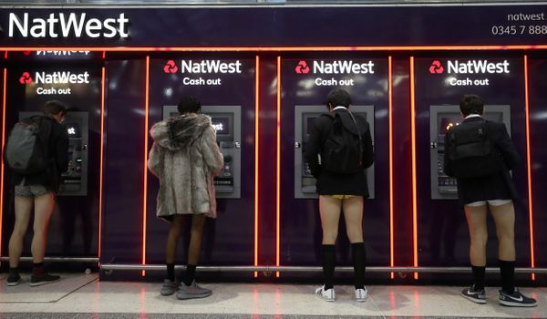 "Passengers without trousers stand at cash machines as part of the ""No Trousers on the Tube Day"" event in London on Jan. 7, 20"