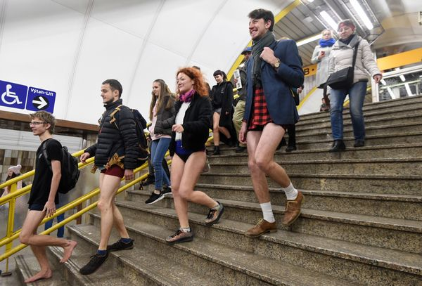 "People in Prague take part in the ""No Pants On The Subway Ride""."