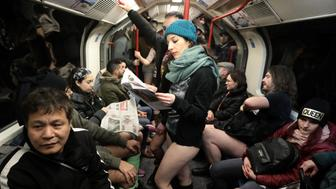 Passengers without trousers travel on a London Underground train as part of the 'No Trousers on the Tube Day' event, in London, Britain January 7, 2018. REUTERS/Simon Dawson