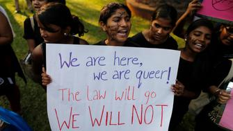 "Gay rights activists shout slogans during a protest against the verdict by the Supreme Court in Mumbai December 15, 2013. India's Supreme Court on Wednesday reinstated a ban on gay sex in the world's largest democracy, following a four-year period of decriminalisation that had helped bring homosexuality into the open in the socially conservative country. In 2009 the Delhi High Court ruled unconstitutional a section of the penal code dating back to 1860 that prohibits ""carnal intercourse against the order of nature with any man, woman or animal"" and lifted the ban for consenting adults. The Supreme Court threw out that decision, saying only parliament could change Section 377 of the penal code, widely interpreted to refer to homosexual sex. Violation of the law can be punished with up to 10 years in jail. REUTERS/Danish Siddiqui (INDIA - Tags: LAW SOCIETY)"