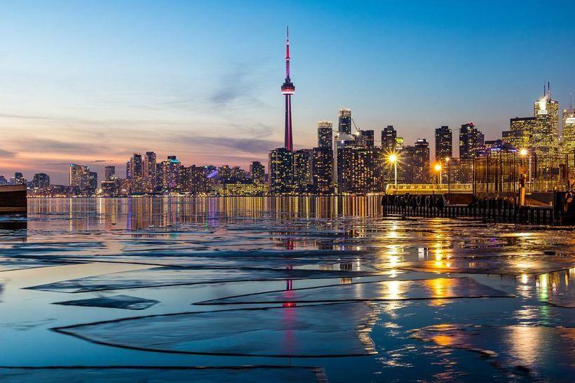 Sun setting behind the Toronto skyline.