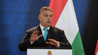 Prime Minister of Hungary Viktor Orban gestures as he gives a joint press conference with his Polish counterpart (not in picture) at the Hungarian parliament in Budapest on January 3, 2018. / AFP PHOTO / Attila KISBENEDEK        (Photo credit should read ATTILA KISBENEDEK/AFP/Getty Images)