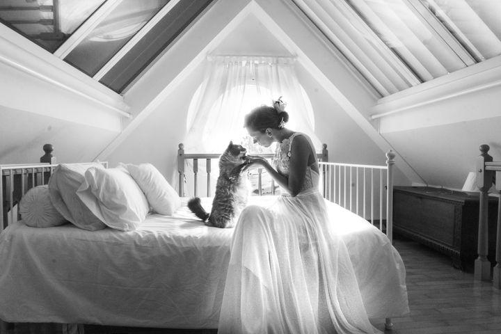 Photographer Marianna Zampieri and her cat Arthurtook post-wedding self-portraits attheir home.