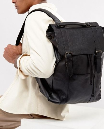 """Get it <a href=""""http://us.asos.com/asos/asos-leather-backpack-in-black/prd/7983293"""" target=""""_blank"""">here</a>."""
