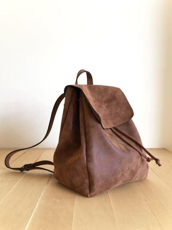 """Get it <a href=""""https://www.etsy.com/listing/488795617/faux-leather-brown-backpack-vegan"""" target=""""_blank"""">here</a>."""