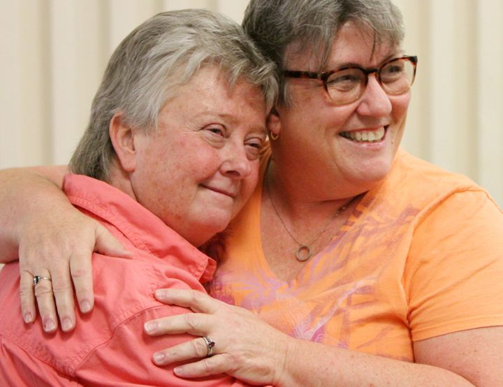 Bobbi Gray (left) and Celeste Swain of Gulfport, Mississippi, pose for photos at the courthouse after getting married on June