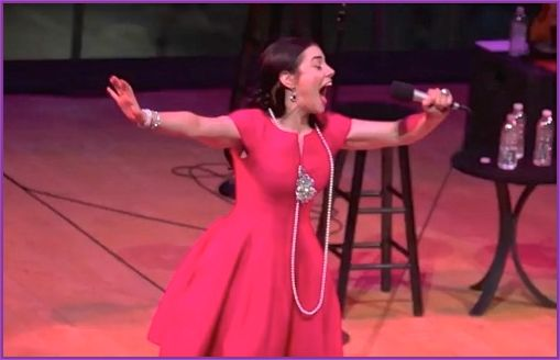 """Meghan Picerno sings <a rel=""""nofollow"""" href=""""https://www.youtube.com/watch?v=jLhqS68P6J4"""" target=""""_blank"""">&quot;Glitter and b"""