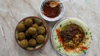 Chickpea-based hummus and falafel at the famed Abu Shukri restaurant in Jerusalem's Old City August 20, 2017. Picture taken August 20, 2017. REUTERS/Ammar Awad