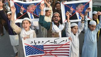 Pakistani demonstrators take part in a protest against US aid cuts in Lahore on January 5, 2018. The United States added bite to its increasingly public spat with Pakistan over militant safe havens December 4, suspending hundreds of millions of dollars in security assistance. President Donald Trump's administration has expressed deep frustration at its South Asian ally's failure to crack down on the Afghan Taliban and Haqqani group bases.  / AFP PHOTO / ARIF ALI        (Photo credit should read ARIF ALI/AFP/Getty Images)
