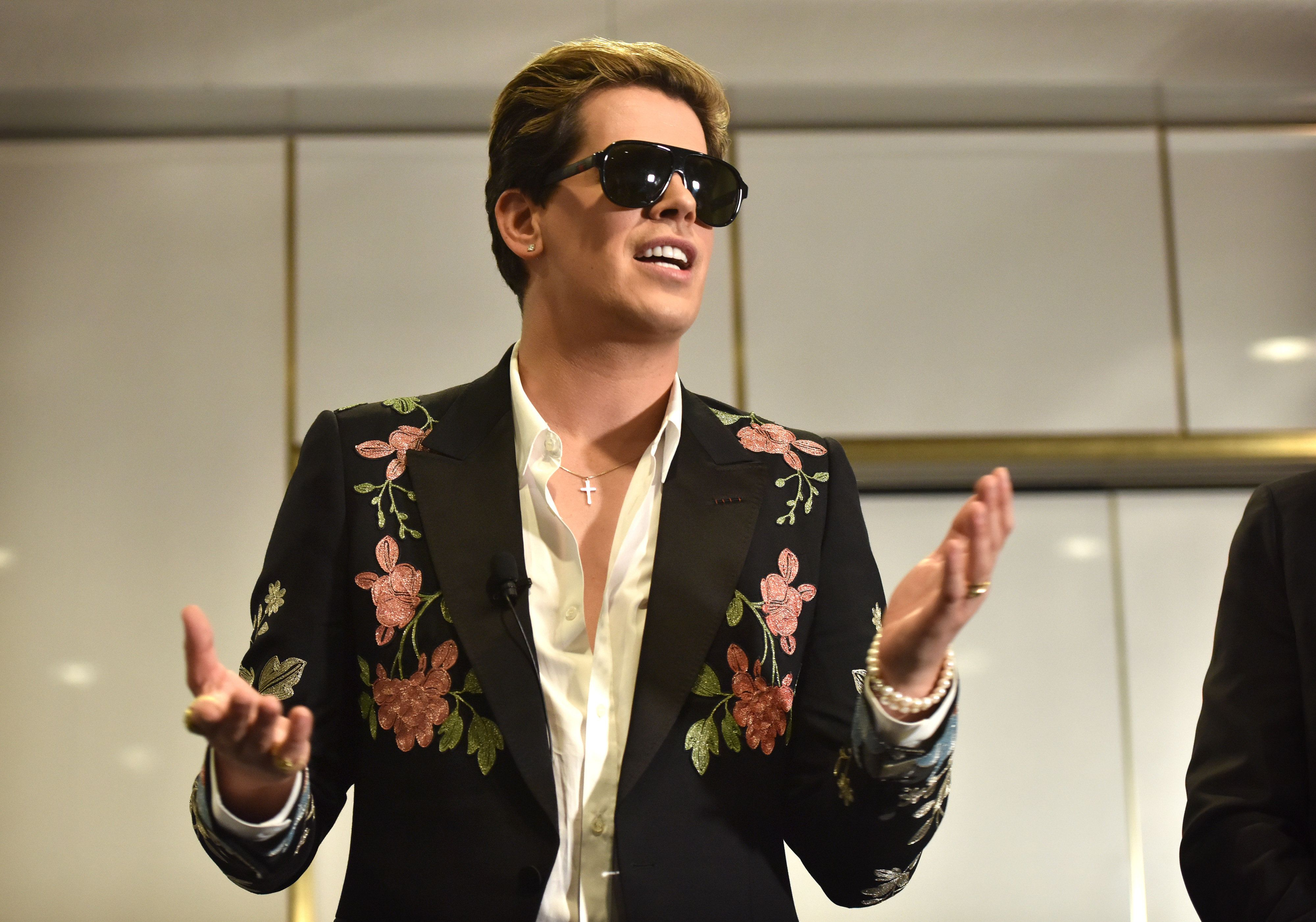 Right-wing British provocateur Milo Yiannopoulos answers questions during a speech at Parliament House in Canberra on December 5, 2017. Yiannopoulos blasted those who do not agree with him as 'petulant babies' after violent protests in Melbourne. The polarising former Breitbart editor is touring with his 'The Troll Academy' speaking show. Hundreds of protestors clashed with police and supporters of Yiannopoulos outside a supposedly secret venue in Melbourne on December 4.  / AFP PHOTO / MARK GRAHAM        (Photo credit should read MARK GRAHAM/AFP/Getty Images)