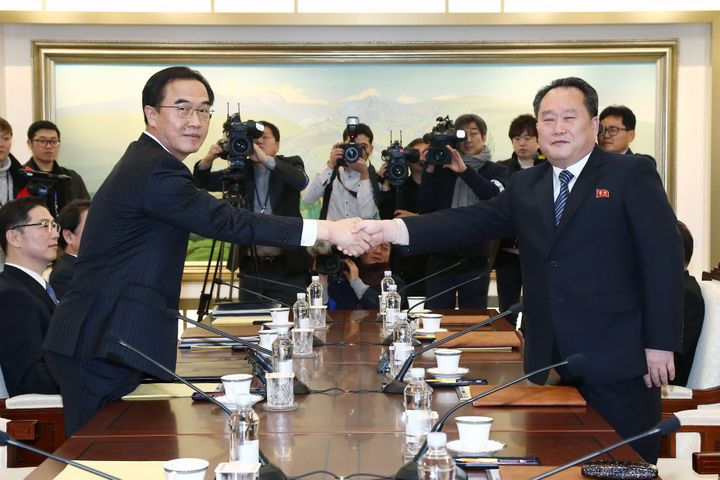 Cho Myoung-gyon, South Korea's unification minister, left, and Ri Son Gwon, chairman of North Koreas Committee for the Peacef
