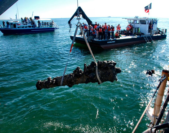 A cannon from Blackbeard's ship Queen Anne's Revenge is hoisted from the sea off the North Carolina shore in 2011.
