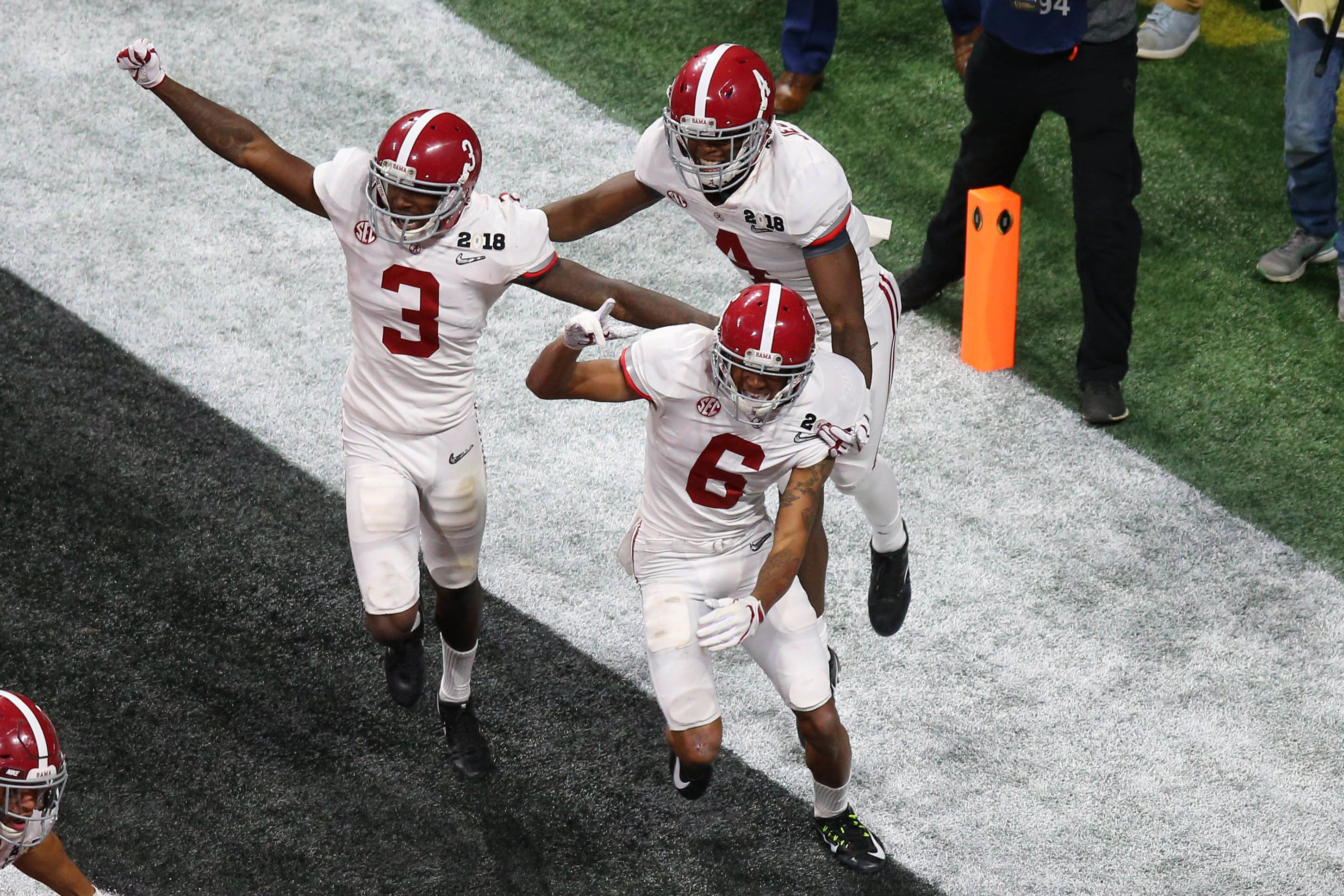 Jan 8, 2018; Atlanta, GA, USA; Alabama Crimson Tide wide receiver DeVonta Smith (6) celebrates his game-winning touchdown in overtime against the Georgia Bulldogs in the 2018 CFP national championship college football game at Mercedes-Benz Stadium. Mandatory Credit: Butch Dill-USA TODAY Sports