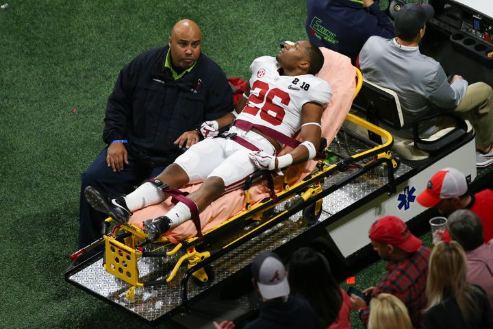 Alabama defensive back Kyriq McDonald (26) appeared to be awake and alert as he was taken off the field.