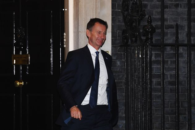 Jeremy Hunt leaves Downing Street after the