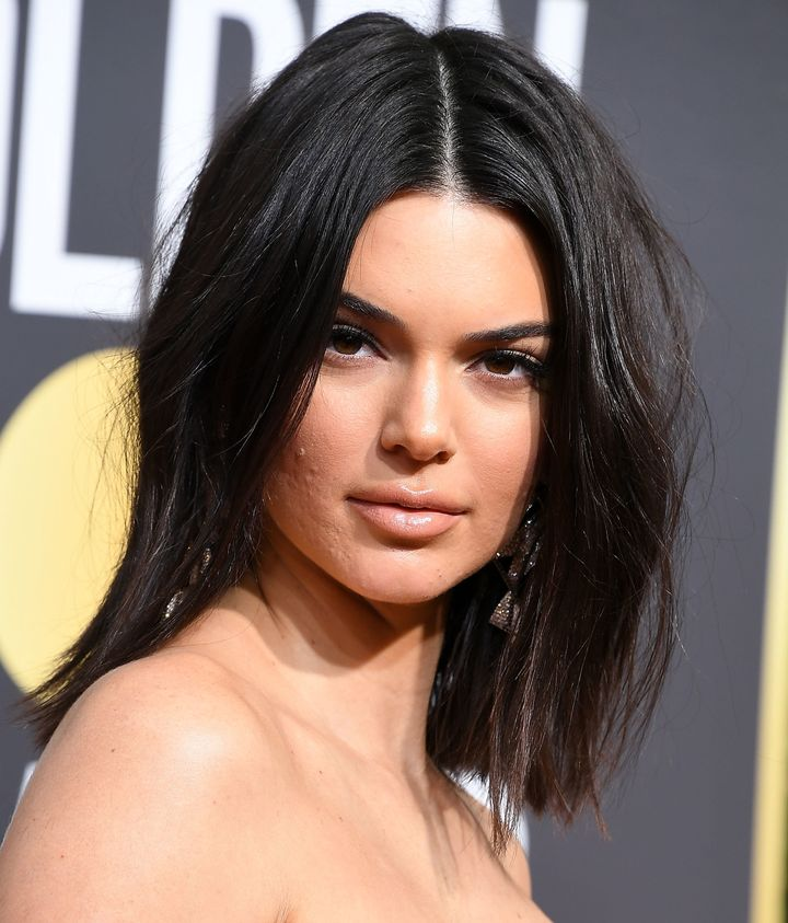 Model Kendall Jenner, pictured at the Golden Globes with some blemishes, just got more beautiful in the eyes of some fans for