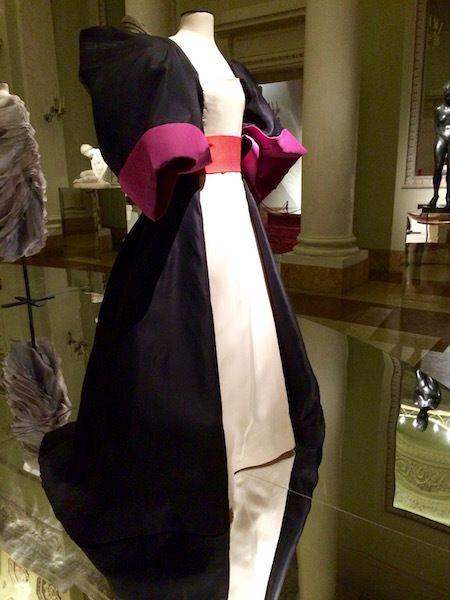 This 1982 ballgown by Roberto Capucci throws caution to the wind by combining fuchsia pink with red, and different textures o