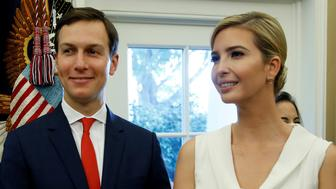 White House Senior Adviser Jared Kushner and Ivanka Trump stand together after John Kelly was sworn in as White House Chief of Staff in the Oval Office of the White House in Washington, U.S., July 31, 2017. REUTERS/Joshua Roberts