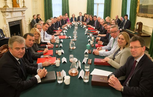 Theresa May poses with her newly constituted cabinet on Tuesday