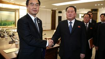 Head of the North Korean delegation, Ri Son Gwon shakes hands with South Korean counterpart Cho Myoung-gyon after their meeting at the truce village of Panmunjom in the demilitarised zone separating the two Koreas, South Korea, January 9, 2018.  REUTERS/Korea Pool
