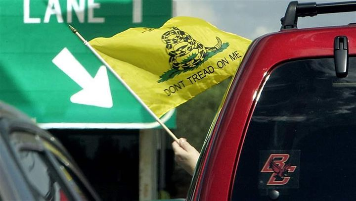 A driver protests a toll in Merrimack, New Hampshire.