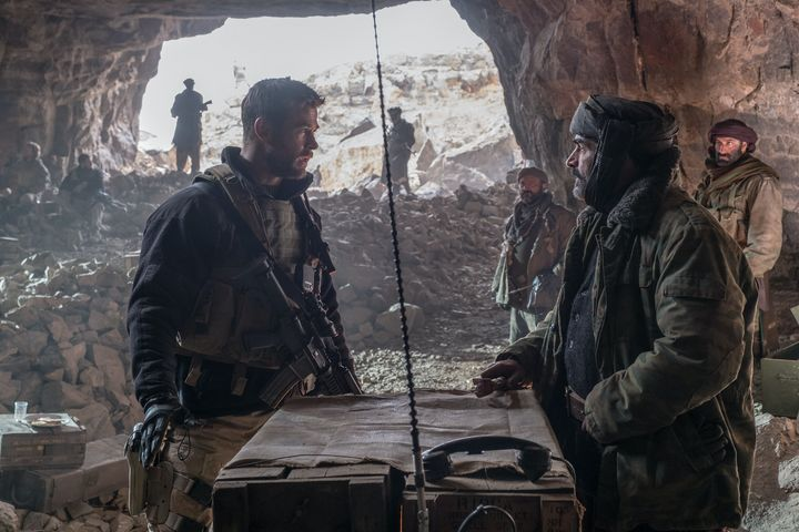 "Chris Hemsworth as Captain Mitch Nelson and Navid Negahban as General Dostum in ""12 Strong."""