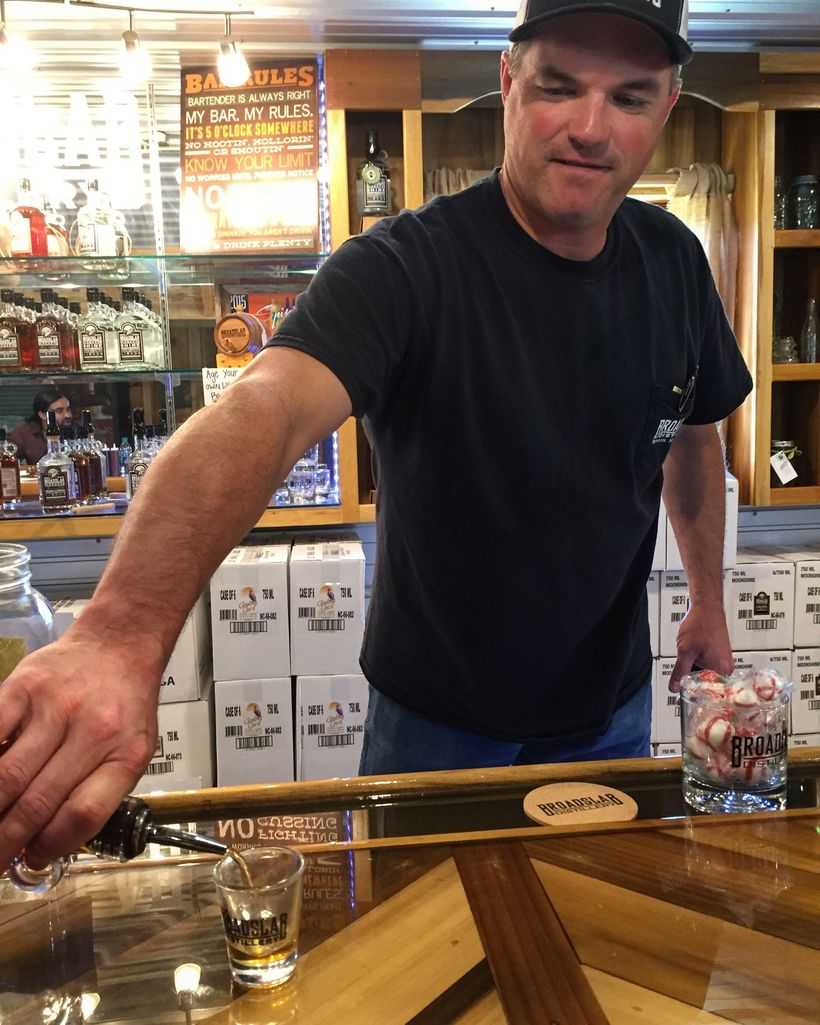 Jeremy Norris pours his Broadslab moonshine on tours, which is made the same way four generations of his family have made it