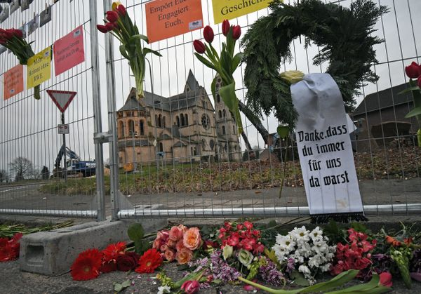 A wreath and flowers are placed in protest against a fence in front of the desacralized St. Lambertus church.