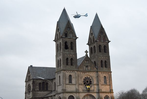 A police helicopter is seen in the sky in Immerath.
