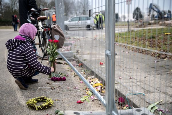 A child places flowers during a demolition of Saint Lambertus church following protests by activists on Jan. 9, 2018 in Immer