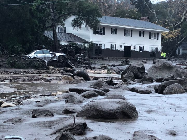 Rain triggered mud and boulders to crash into homes in Montecito, California.