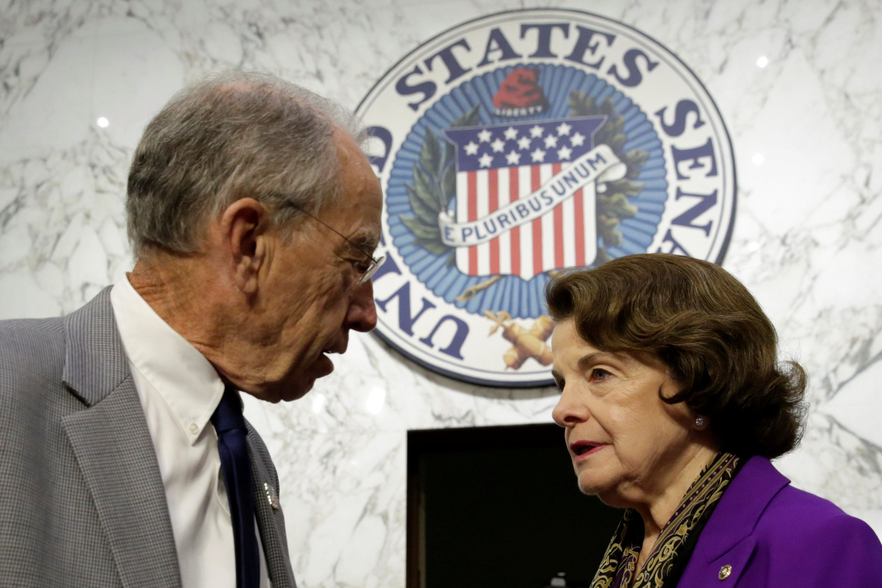 Senate Judiciary Committee Chairman Charles Grassley (R-IA) (L) and Sen. Dianne Feinstein (D-CA) speak before a continuation of Senate Judiciary Committee hearing on alleged Russian meddling in the 2016 presidential election on Capitol Hill in Washington, U.S., July 27, 2017. REUTERS/Yuri Gripas