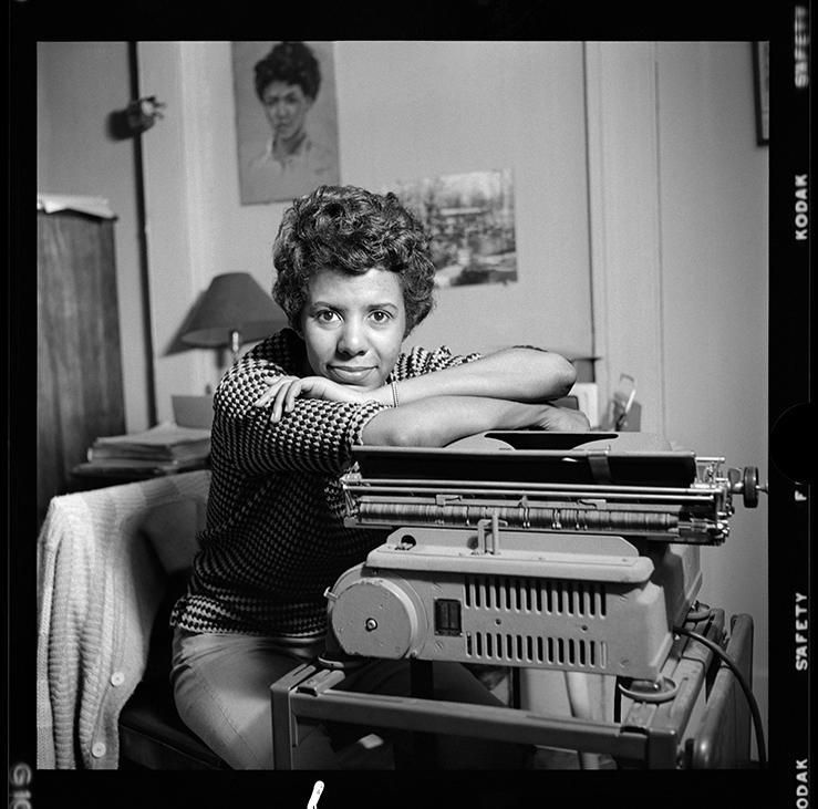<em>Lorraine  Hansberry leans over her typewriter in her Greenwich Village apartment  on Bleecker Street during her April 19