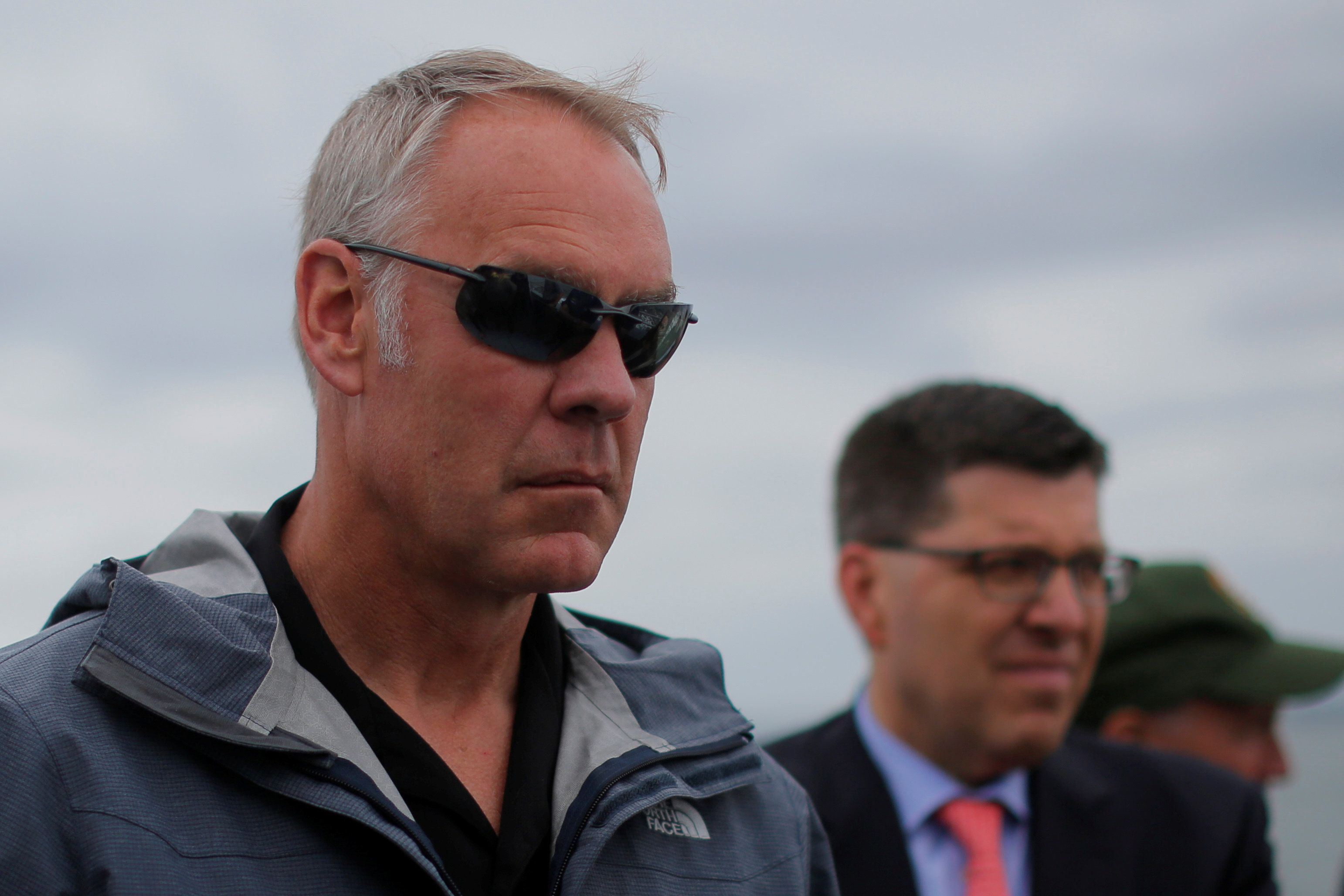 U.S. Interior Secretary Ryan Zinke rides a boat to Georges Island, while traveling for his National Monuments Review process, in Boston Harbor, Massachusetts, U.S., June 16, 2017.  Picture taken June 16, 2017.   REUTERS/Brian Snyder