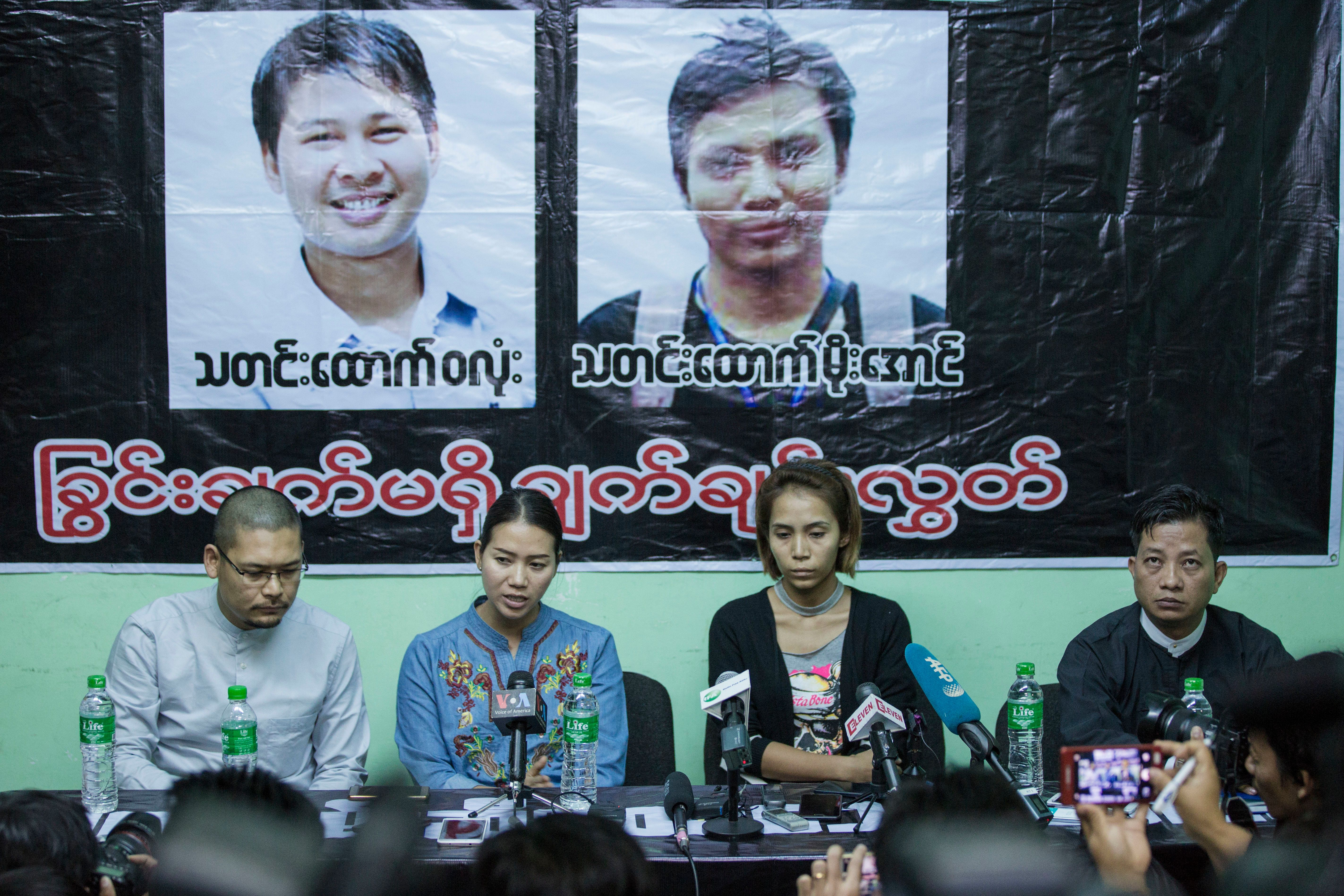 Pan Ei Mon, center left, wife of Reuters journalist Wa Lone, and Nyo Nyo Aye, center right, sister of Reuters reporter Kyaw S