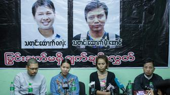 Pan Ei Mon (C-L), wife of Reuters journalist Wa Lone, and Nyo Nyo Aye (C-R), sister of Reuters reporter Kyaw Soe Oo, talk to journalists during a press briefing in Yangon on December 28, 2017. Two Reuters journalists were remanded in custody for another fortnight by a Myanmar court on December 28, following their first public appearance since being arrested under a secrecy law that carries up to 14 years in jail.  / AFP PHOTO / SAI AUNG MAIN        (Photo credit should read SAI AUNG MAIN/AFP/Getty Images)