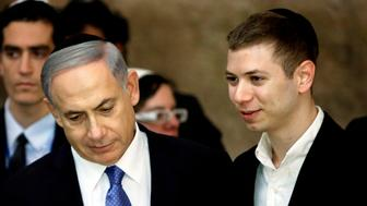 A picture taken on March 18, 2015 shows Israeli Prime Minister Benjamin Netanyahu (L) and his son Yair visiting the Wailing Wall in Jerusalem. The son of Israeli Prime Minister Benjamin Netanyahu faced online criticism on September 9, 2017 after sharing an image on his Facebook page deemed anti-Semitic by critics. / AFP PHOTO / THOMAS COEX        (Photo credit should read THOMAS COEX/AFP/Getty Images)