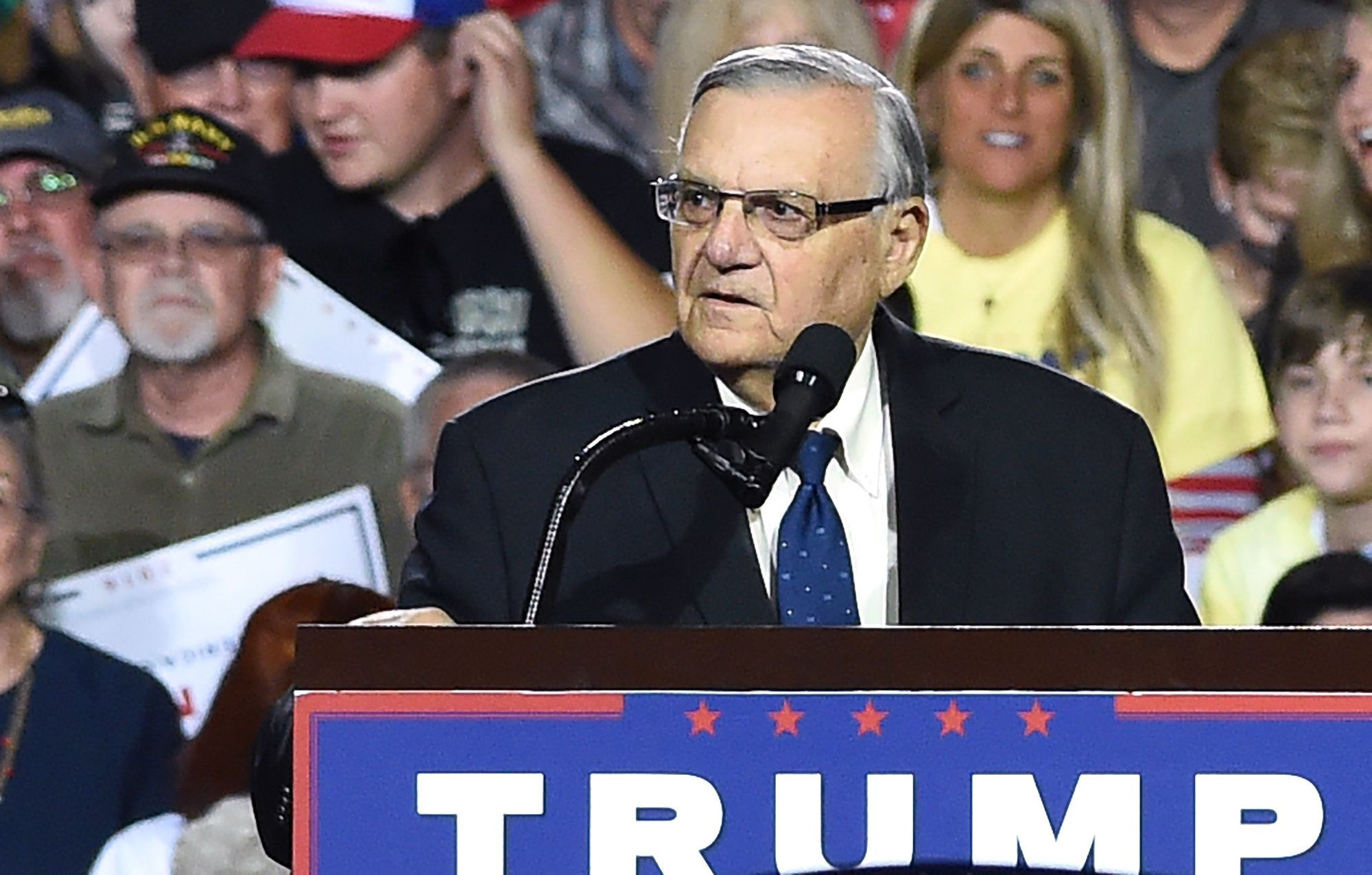 Sheriff Joe Arpaio attends a rally by Republican presidential candidate Donald Trump, October 4, 2016, in Prescott Valley, Arizona. Arpaio will soon face criminal charges from federal prosecutors over his immigration patrols.  Federal prosecutors say they will charge Arpaio with contempt-of-court after he allegedly failed to obey a judges order to halt controversial immigration policies that some say include racial profiling.  / AFP / Robyn Beck        (Photo credit should read ROBYN BECK/AFP/Getty Images)