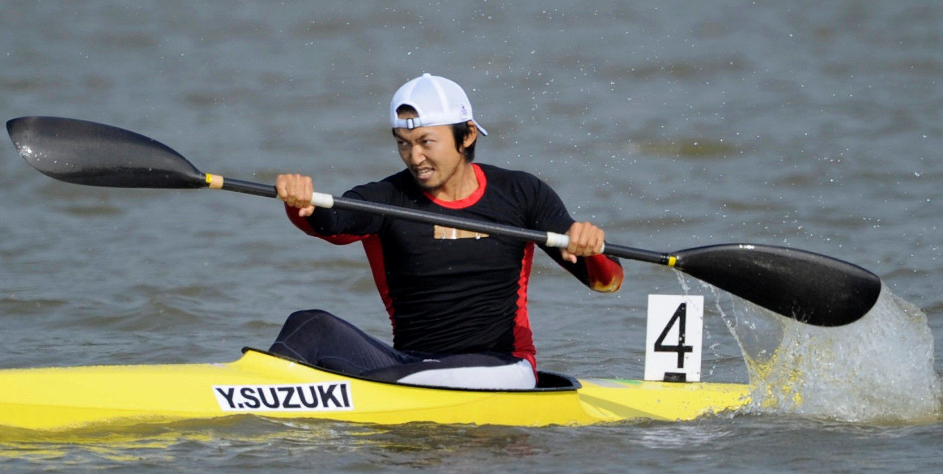 Japan's Yasuhiro Suzuki competes in the men's kayak single race at the 16th Asian Games in Guangdong province, China, in this photo taken by Kyodo on November 25, 2010.  Mandatory credit Kyodo/via REUTERS ATTENTION EDITORS - THIS IMAGE WAS PROVIDED BY A THIRD PARTY. MANDATORY CREDIT. JAPAN OUT. NO COMMERCIAL OR EDITORIAL SALES IN JAPAN.